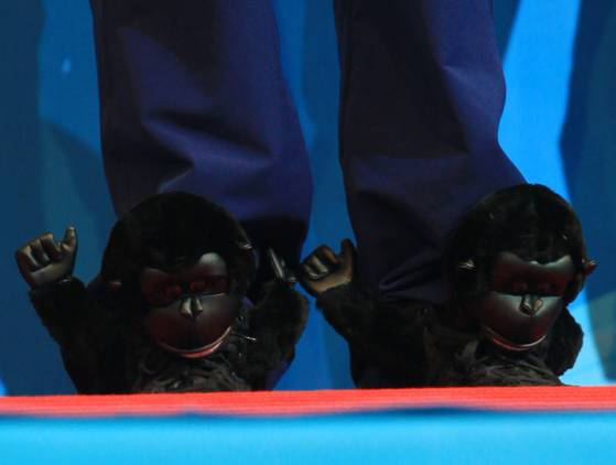 lochte gorilla shoes Pictures: Swimmer Ryan Lochte wins 6 golds at the short course world championships, wears ridiculous animal sneakers
