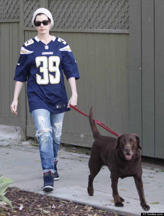 Anne Hathaway takes her dog for a walk