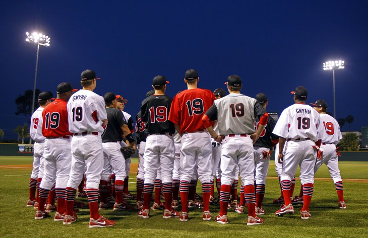 SDSU baseball players wore Tony Gwynn's jerseys for the national anthem prior to their home opener against Washington on Friday, Feb. 17, 2012. Gwynn, the coach of the Aztecs is in the hospital recovering from surgery after removing a tumor in his cheek. — K.C. Alfred, UT San Diego